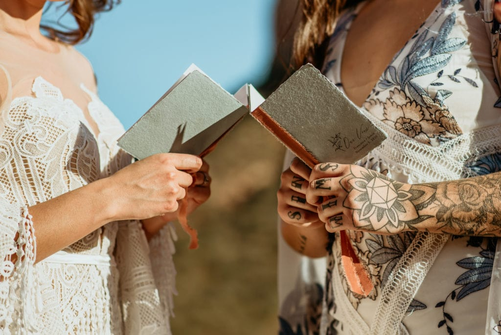 Vow books during Courthouse Butte elopement