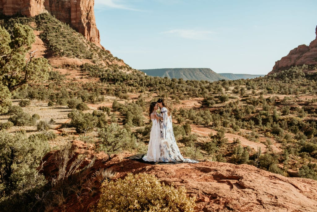 Two brides standing at a gorgeous Sedona overlook
