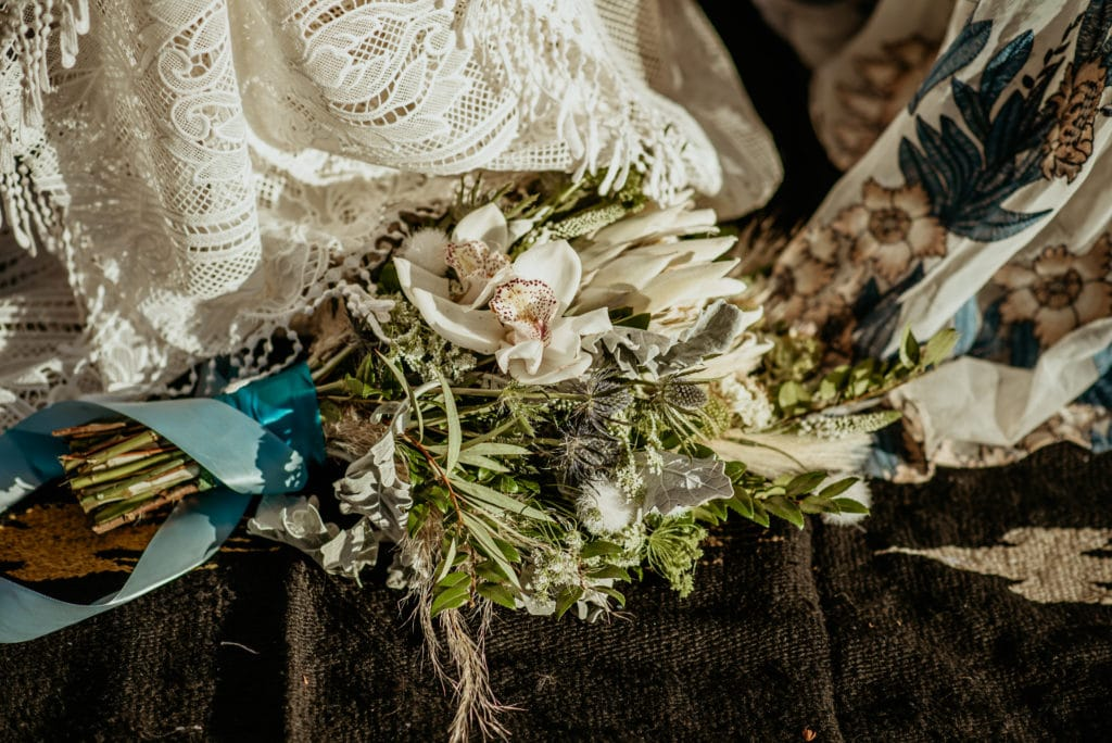 Gorgeous white and blue bouquet with orchids during Baby Bell elopement