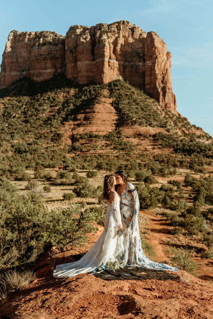 Courthouse Butte towering in the background during elopement in Sedona