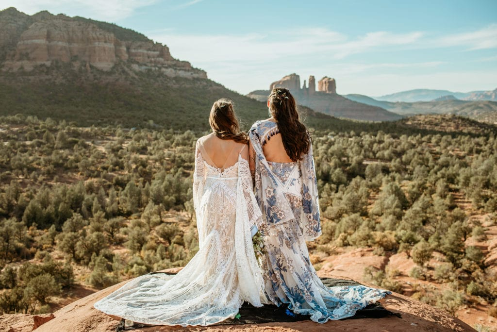 Gorgeous flowing Rue De Seine gowns on two brides during Baby Bell Rock elopement