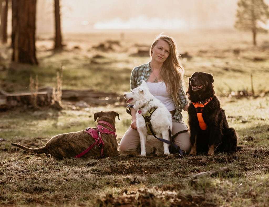 Arizona elopement photographer Shannon Durazo from Stratus Adventure Photography with her dogs in the forest