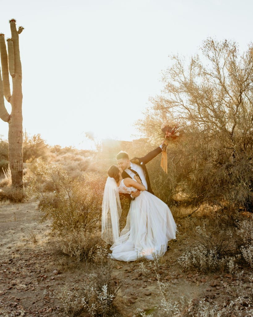 Bride and groom at sunset during their Arizona elopement