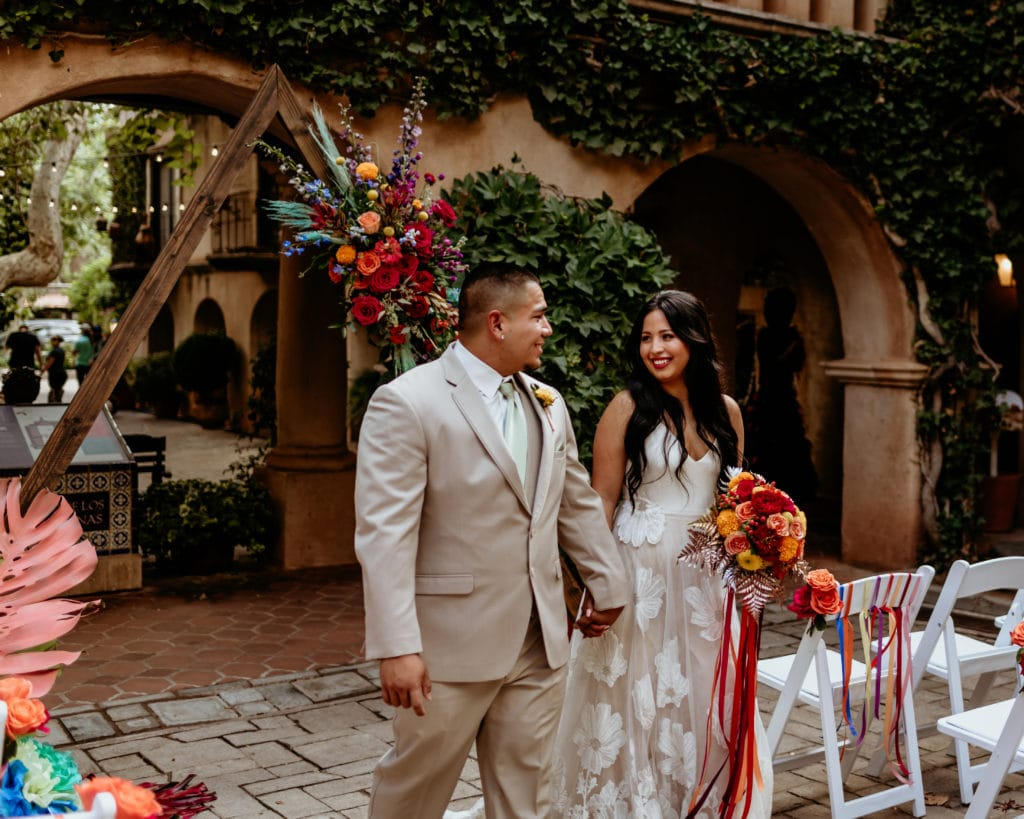 Bride and groom walking down the isle at Tlaquepaque