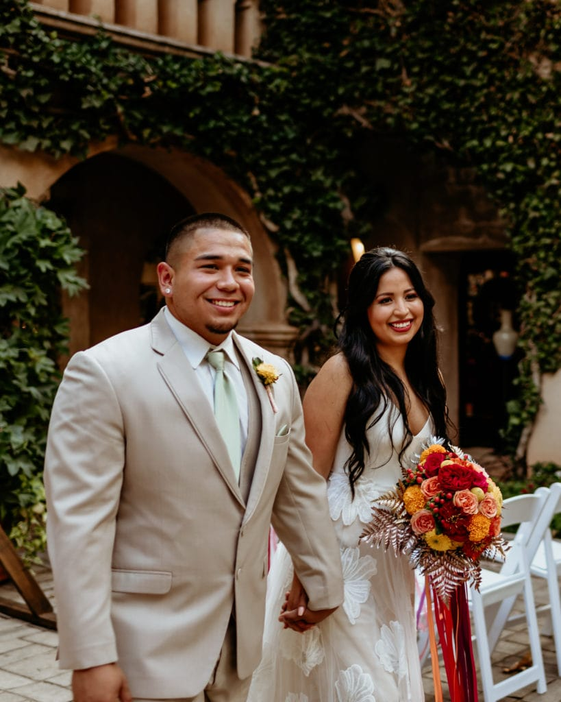 Latino couple walking back down the isle of their Tlaquepaque wedding