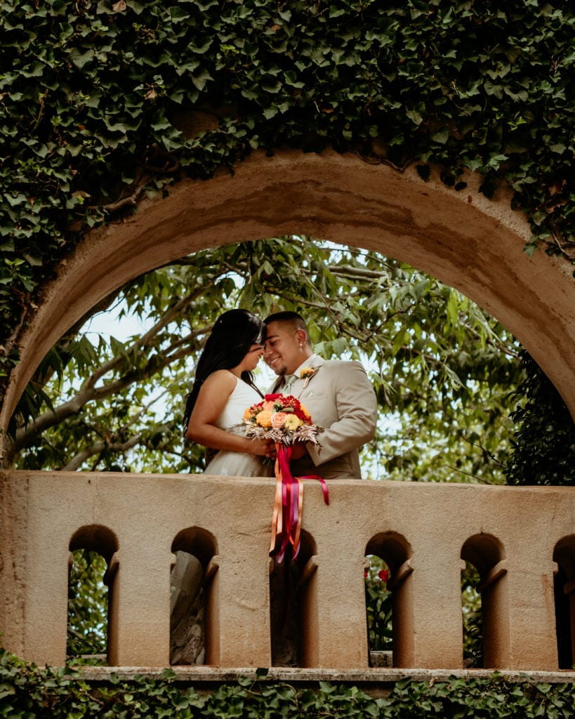 Bride and groom on ivy lined balcony at Tlaquepaque