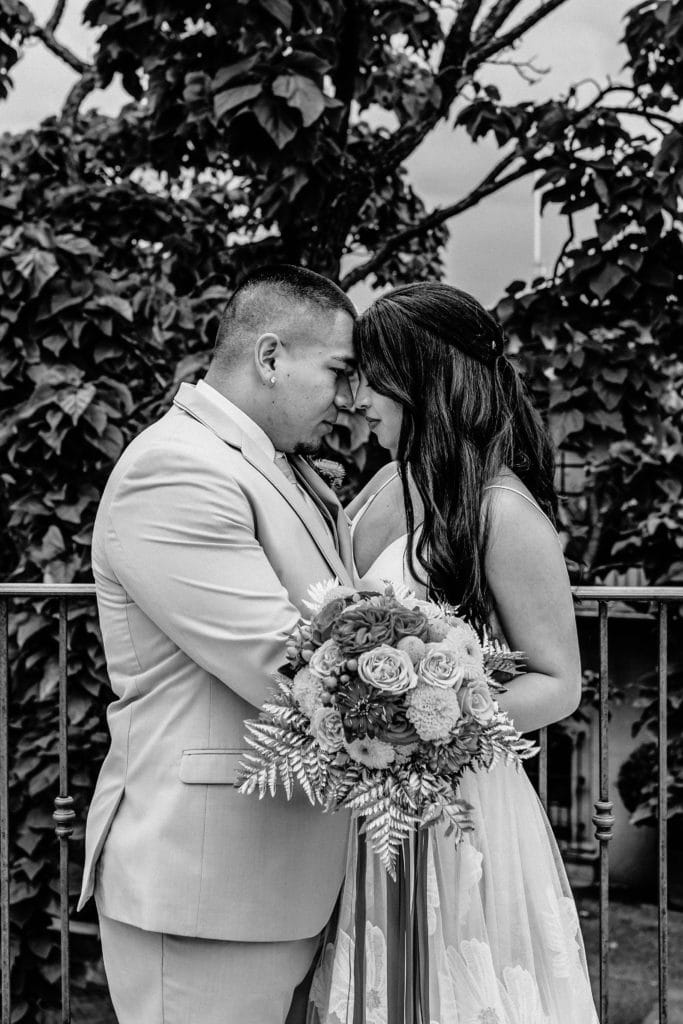 Bride and groom taking a moment on the Tlaquepaque balcony