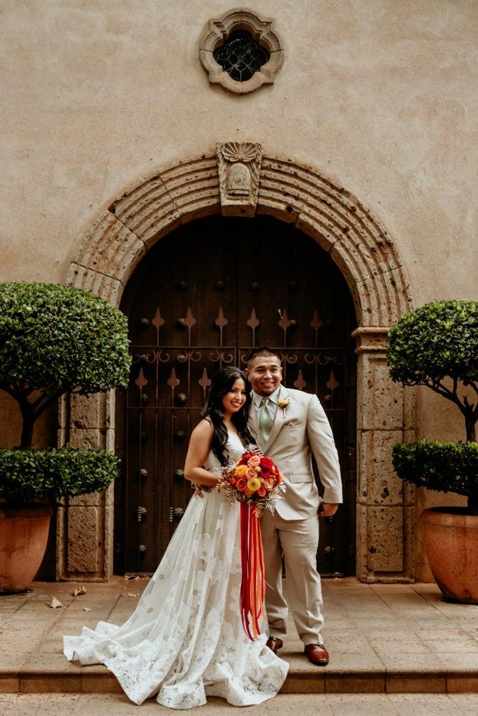 Bride and groom in front of the Tlaquepaque chapel doorway
