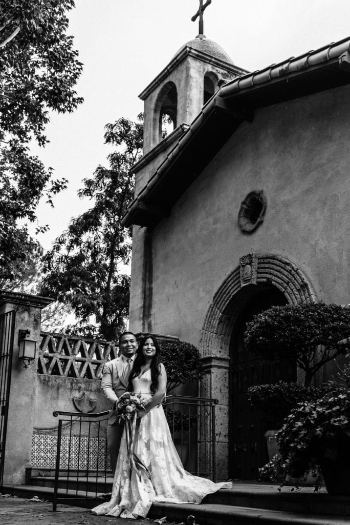 View of the Tlaquepaque chapel and bell with elopement couple standing in front