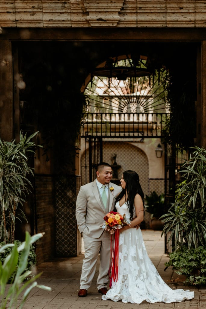 Wedding couple looking into each others eyes under one of the Tlaquepaque arches