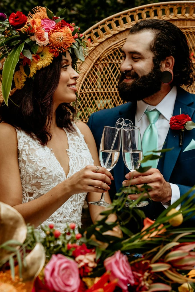 Bride and groom toasting champagne at their Tlaquepaque intimate wedding reception