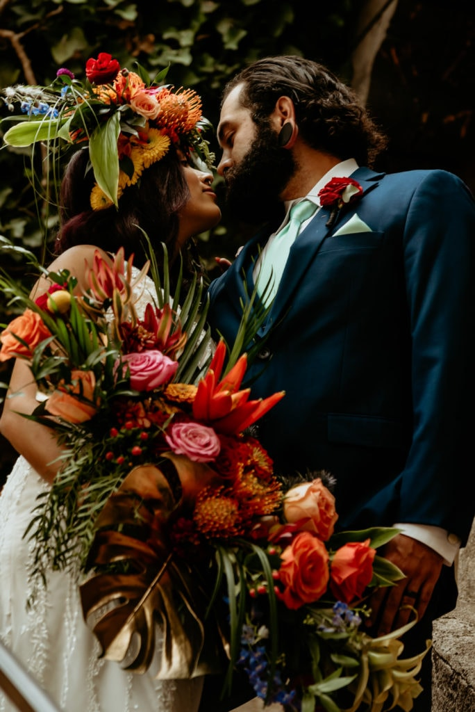 Bold and colorful tropical bouquet held by bride