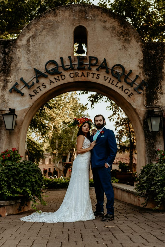 Bride and groom in front of the Tlaquepaque main entrance