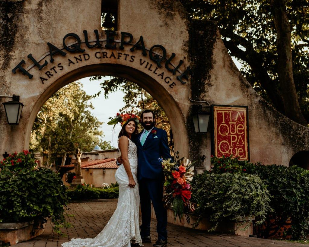 Bride and groom being goofy in front of Tlaquepaque