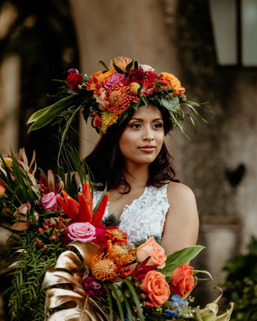 Bridal portrait with tropical headdress and bouquet