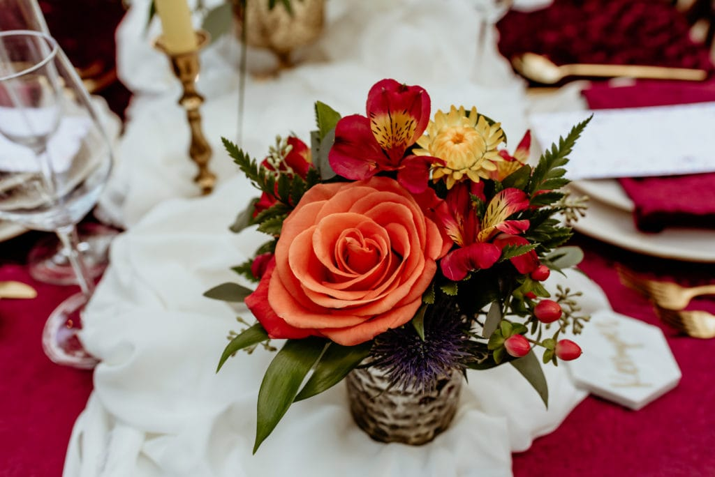 Orange, red and yellow table floral arrangement
