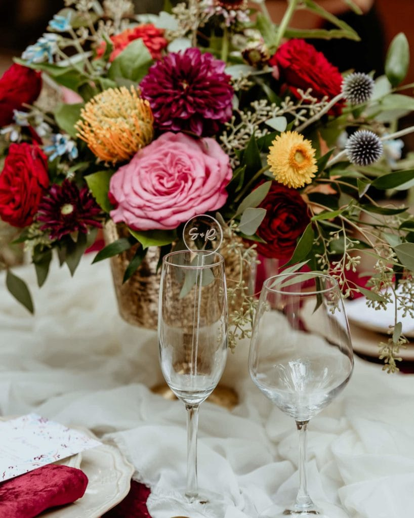 Beautiful vibrant table florals during an intimate wedding at Tlaquepaque