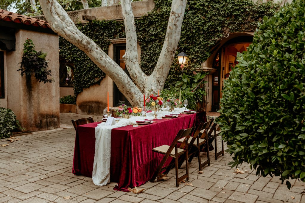 Reception table setup for courtyard reception dinner