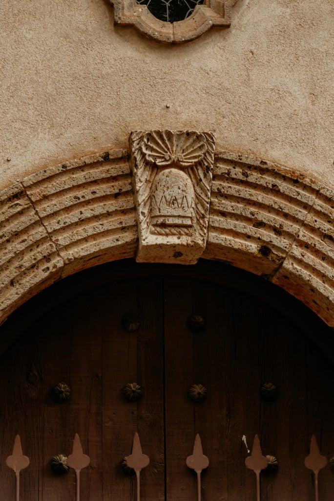 Stone ornamentation above Tlaquepaque chapel doorway