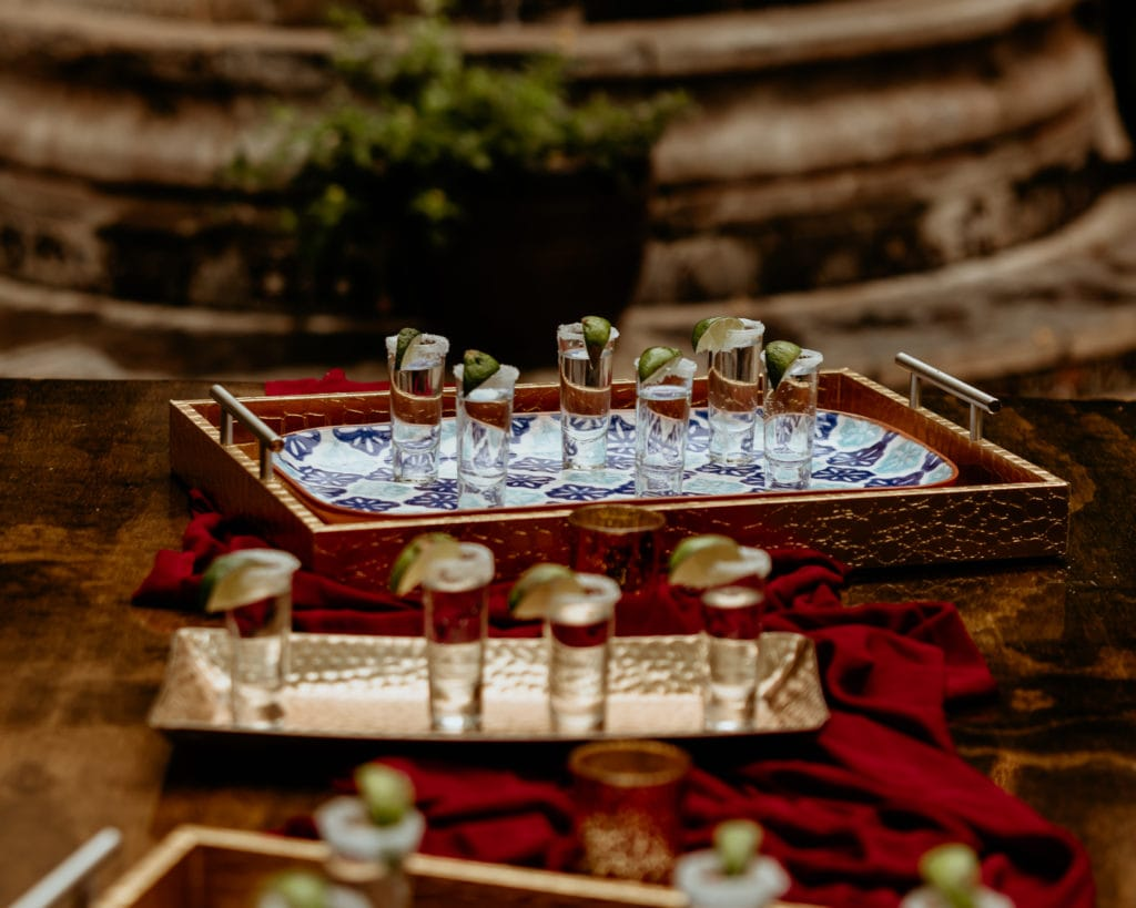 Tequila shots with salt and lime covered rims for the intimate wedding reception at Tlaquepaque