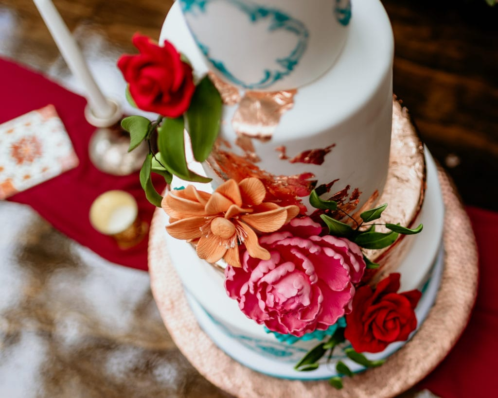 Incredible 3 tiered cake with colorful edible fowers