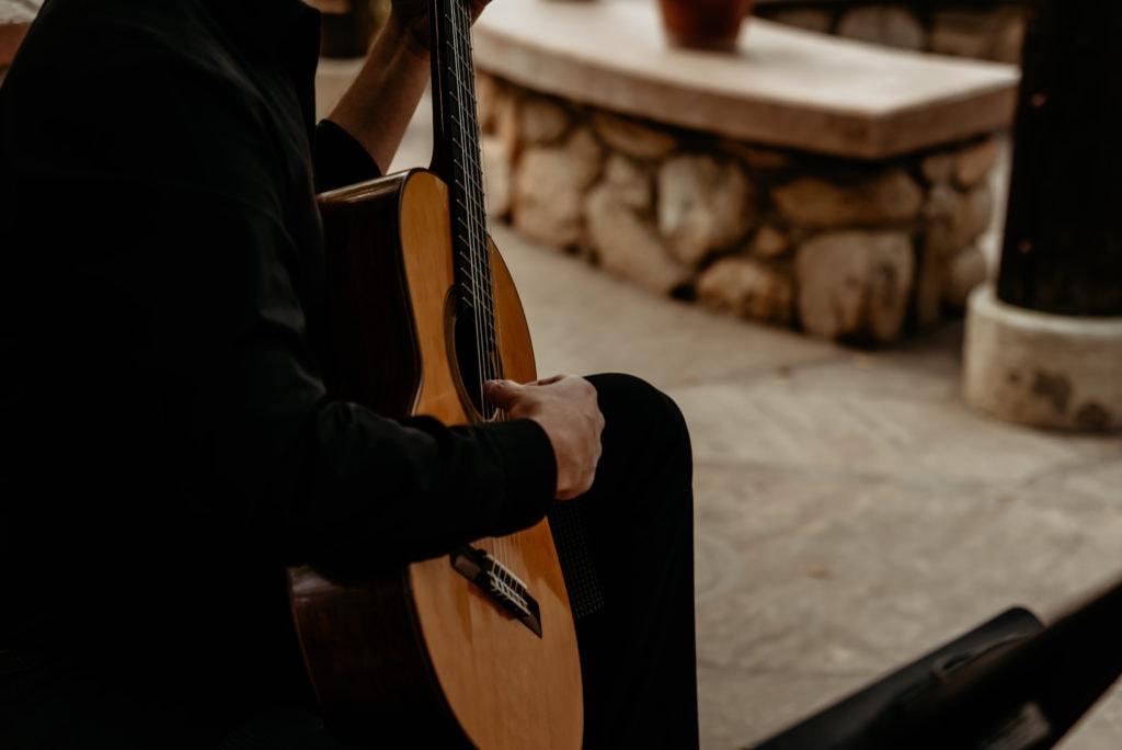 Live guitar music during botanical garden wedding