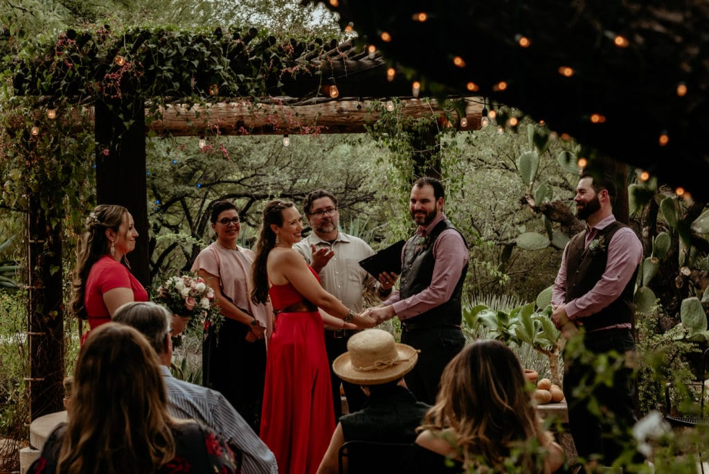 Vines and trees with lights surround happy wedding couple during their Tucson Intimate Wedding