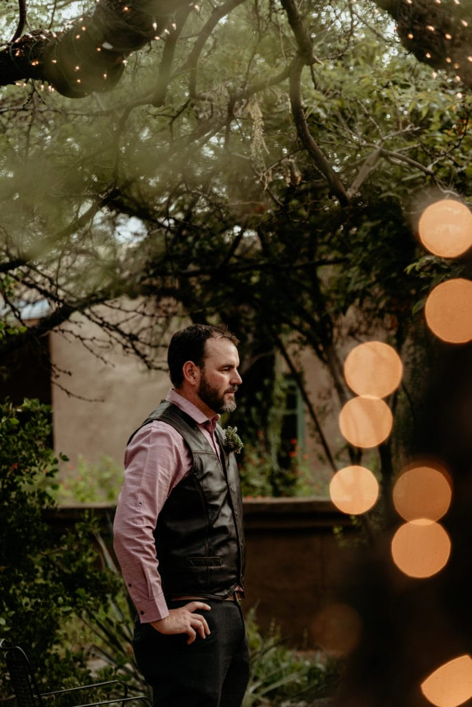 groom watching is beautiful wife to be walking down the isle at the Tucson Botanical Gardens