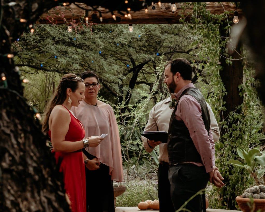 Bride reading her vows during Tucson Garden Wedding